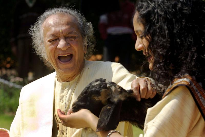 FILE - In this Feb. 25, 2002 file photo, Sitar maestro Pandit Ravi Shankar, left, and his daughter Anoushka Shankar laugh during the shooting of a film endorsing the strengthening of Indian laws against animal cruelty in New Delhi. Shankar, the sitar virtuoso who became a hippie musical icon of the 1960s after hobnobbing with the Beatles and who introduced traditional Indian ragas to Western audiences over an eight-decade career, died Tuesday, Dec. 11, 2012. He was 92. (AP photo/Gurinder Osan, File)
