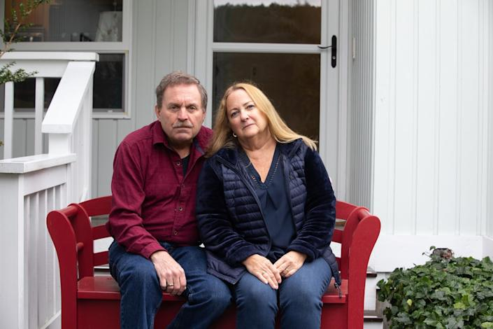 "Jim Owen and Carolynn Comstock, singers in the Skagit Valley Chorale, sit outside their home in Anacortes, Wash. <span class=""copyright"">(Karen Ducey / For The Times)</span>"