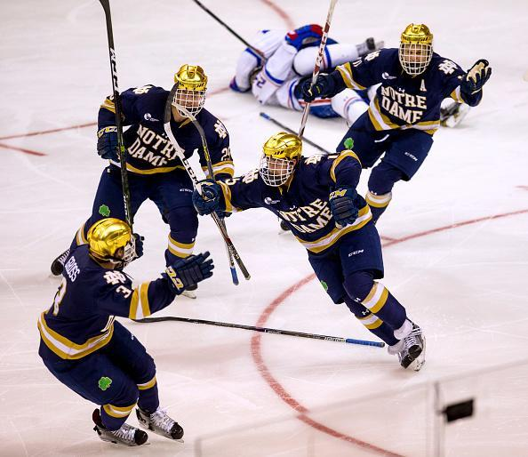 MANCHESTER, NH – MARCH 26: Andrew Oglevie #15 of the Notre Dame Fighting Irish celebrates his overtime winning goal against the Massachusetts Lowell River Hawks during the NCAA Division I Men's Ice Hockey Northeast Regional Championship final at the SNHU Arena on March 26, 2017 in Manchester, New Hampshire. The Fighting Irish won 3-2 and advance to the Frozen Four in Chicago. (Photo by Richard T Gagnon/Getty Images)