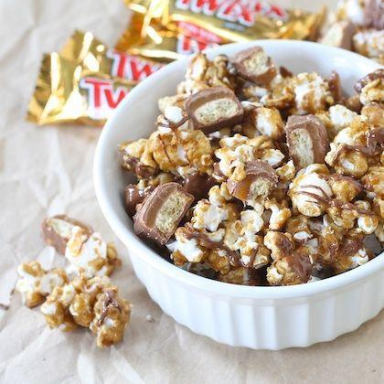 """<div class=""""caption-credit""""> Photo by: Two Peas and Their Pod</div><div class=""""caption-title"""">Twix® Caramel Popcorn</div>This is a great way to use up leftover Easter candy. Yum! <br> <a href=""""http://www.twopeasandtheirpod.com/twix-caramel-popcorn/"""" rel=""""nofollow noopener"""" target=""""_blank"""" data-ylk=""""slk:Get the recipe"""" class=""""link rapid-noclick-resp""""><i>Get the recipe</i></a> <br> <b>More on Spoonful</b> <br> <a href=""""http://spoonful.com/recipes/fun-party-foods?cmp=ELP