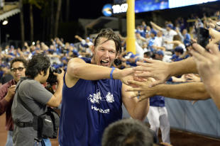 Kershaw with Dodgers fans after L.A.'s 4-3 victory over the Braves. (USA Today)