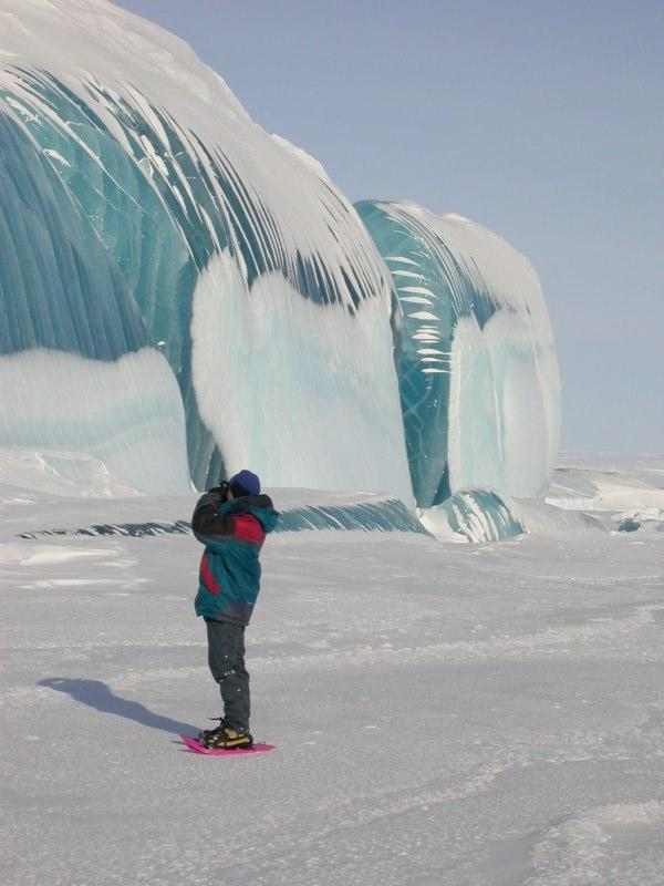 """The giant waves covered in a brilliant blue sheen are actually giant icicles, <a href=""""http://www.snopes.com/photos/natural/antarcticwave.asp"""" rel=""""nofollow noopener"""" target=""""_blank"""" data-ylk=""""slk:according to rumor-busting website Snopes.com"""" class=""""link rapid-noclick-resp"""">according to rumor-busting website Snopes.com</a>. """"The beautiful smoothly polished surfaces are again the result of melting,"""" it notes. """"The transparent ice … has been created in a glacier or ice cap by the slow annealing of ice as it is buried under each year's successive accumulation of snow."""" <a href=""""http://www.astro.caltech.edu/~tonyt/Tonys_site/About_Me.html"""" rel=""""nofollow noopener"""" target=""""_blank"""" data-ylk=""""slk:(Photo by Tony Travouillon)"""" class=""""link rapid-noclick-resp"""">(Photo by Tony Travouillon)</a>"""