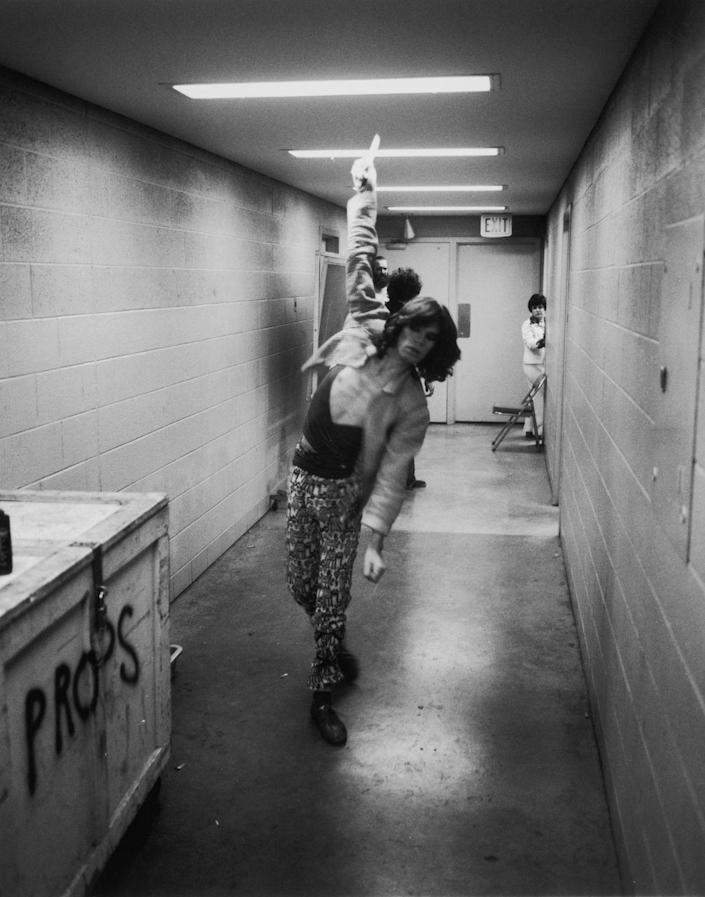 <p>Mick Jagger practices his bowling in the corridor during the Rolling Stones Tour of the Americas, 1975.</p>