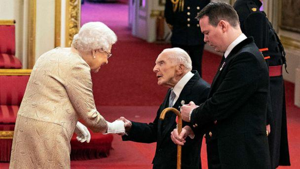 PHOTO: Queen Elizabeth wears gloves as she awards the MBE (Member of the Order of the British Empire) to Harry Billinge from St Austell, during an investiture ceremony at Buckingham Palace in London, March 3, 2020. (Dominic Lipinski/AP)