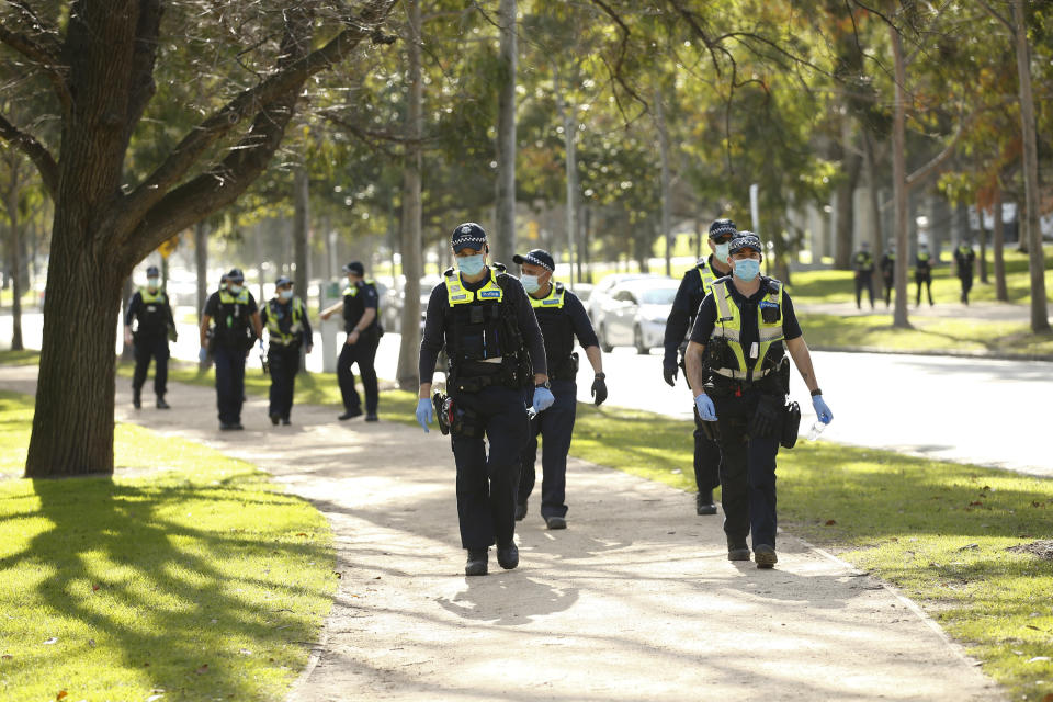 Police patrol the streets of Melbourne as the state looks to get to grips on an escalating coronavirus crisis. Source: AAP