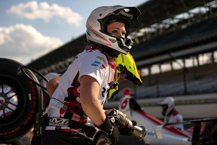 Paretta crew member Mallorie Muller gets ready to run through a practice pit stop during open testing for the Indy 500 on April 9.