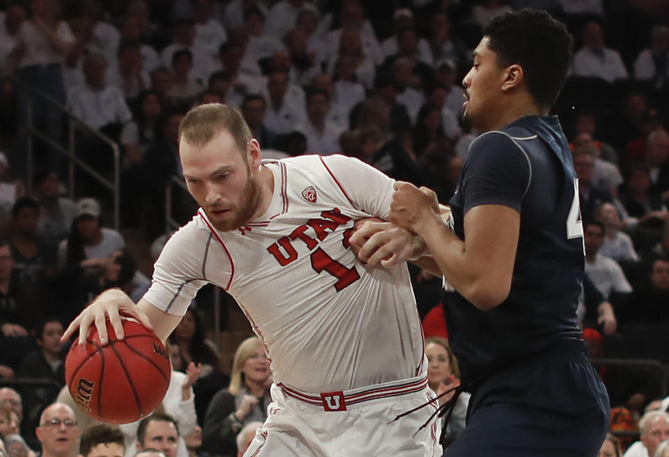 Utah forward David Collette (13) drives against Penn State forward Julian Moore (44) during the first quarter of an NCAA college basketball game for the NIT championship Thursday, March 29, 2018, in New York. (AP Photo/Julie Jacobson)