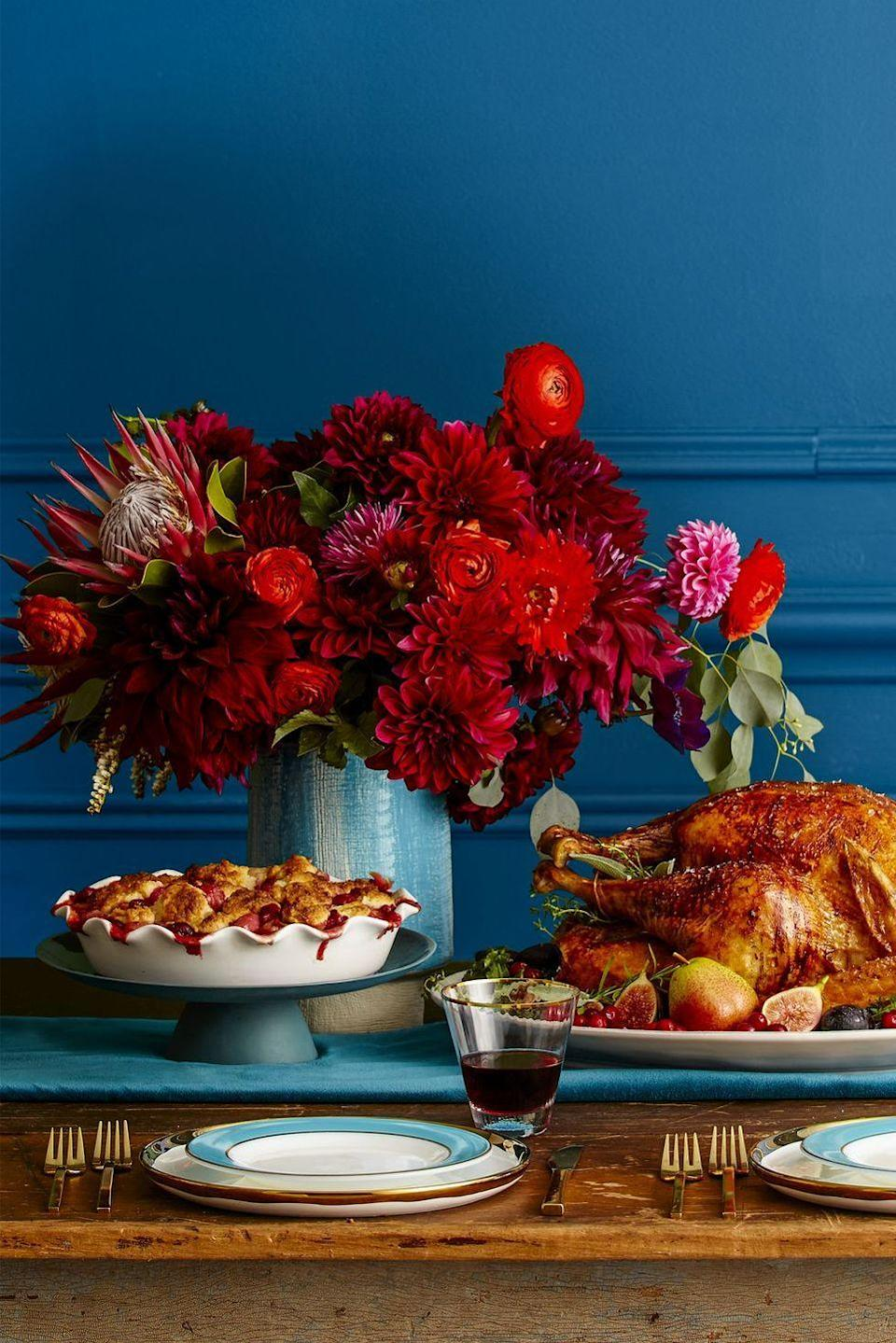 """<p>A vibrant arrangement is a guaranteed head-turner at any dinner party, but it'll be especially appreciated on Thanksgiving Day. Dahlias, roses, and ranunculus will fit right in with all the red-hued pies and cranberry sauce on your table.</p><p><a class=""""link rapid-noclick-resp"""" href=""""https://www.amazon.com/Artificial-Flowers-Red-Plants/s?rh=n%3A14087331%2Cp_n_feature_twenty_browse-bin%3A3254103011&tag=syn-yahoo-20&ascsubtag=%5Bartid%7C10050.g.2130%5Bsrc%7Cyahoo-us"""" rel=""""nofollow noopener"""" target=""""_blank"""" data-ylk=""""slk:SHOP RED ARTIFICIAL FLOWERS"""">SHOP RED ARTIFICIAL FLOWERS</a></p>"""