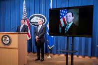 Assistant Attorney General for National Security John C. Demers and FBI Director Christopher Wray attend a virtual news conference at the Department of Justice in Washington