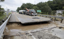 FILE - This Aug. 21, 2018, file photo, shows a milk truck damaged after it fell into the missing section of a bridge over Highway 14 in Black Earth, Wis. More than 11 inches of rain fell overnight in places in or around Madison, according to the National Weather Service. Officials in Dane County say this week's flooding caused more than $100 million in damage. (Steve Apps/Wisconsin State Journal via AP, File)