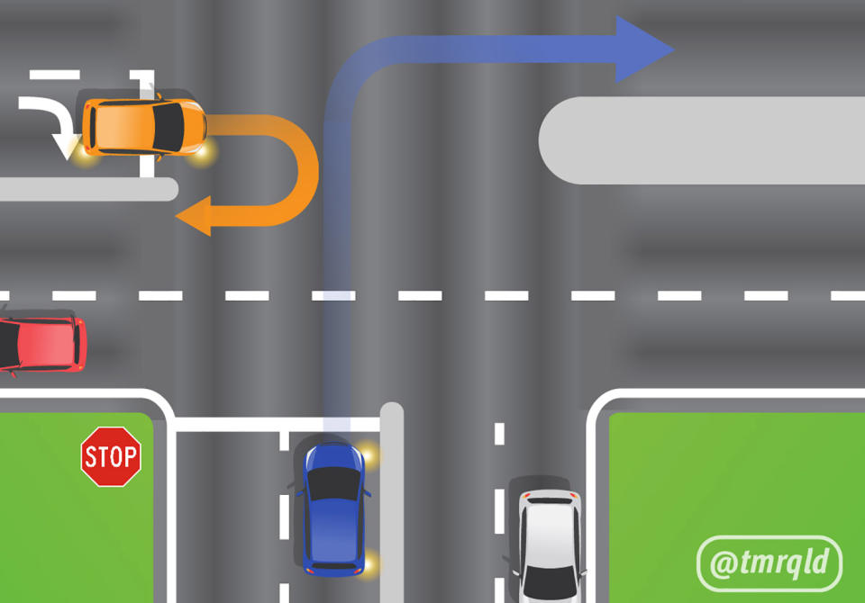 An orange car prepares to u-turn with a blue car looking to enter an intersection from a stop sign.