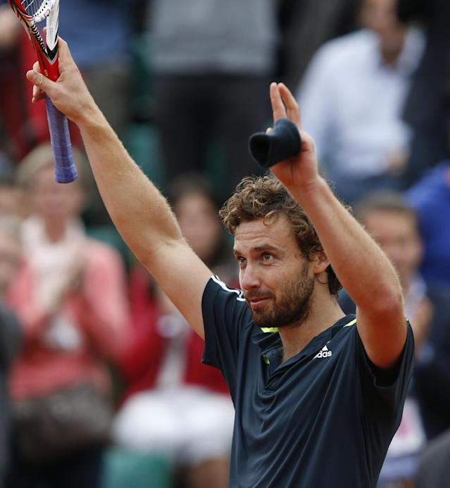 Latvia's Ernests Gulbis celebrates winning the quarterfinal match of the French Open tennis tournament against Tomas Berdych of the Czech Republic at the Roland Garros stadium, in Paris, France, Tuesday, June 3, 2014. Gulbis won in three sets 6-3, 6-2, 6-4. (AP Photo/Darko Vojinovic)