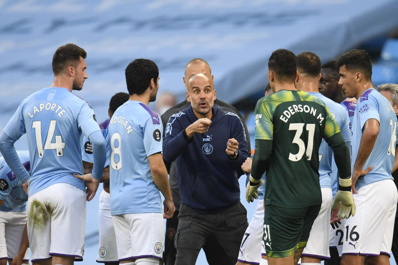 Pep Guardiola (center) and Manchester City have addressed defensive shortcomings and appear ready to reclaim the Premier League title. (Photo by Peter Powell/Pool via Getty Images)
