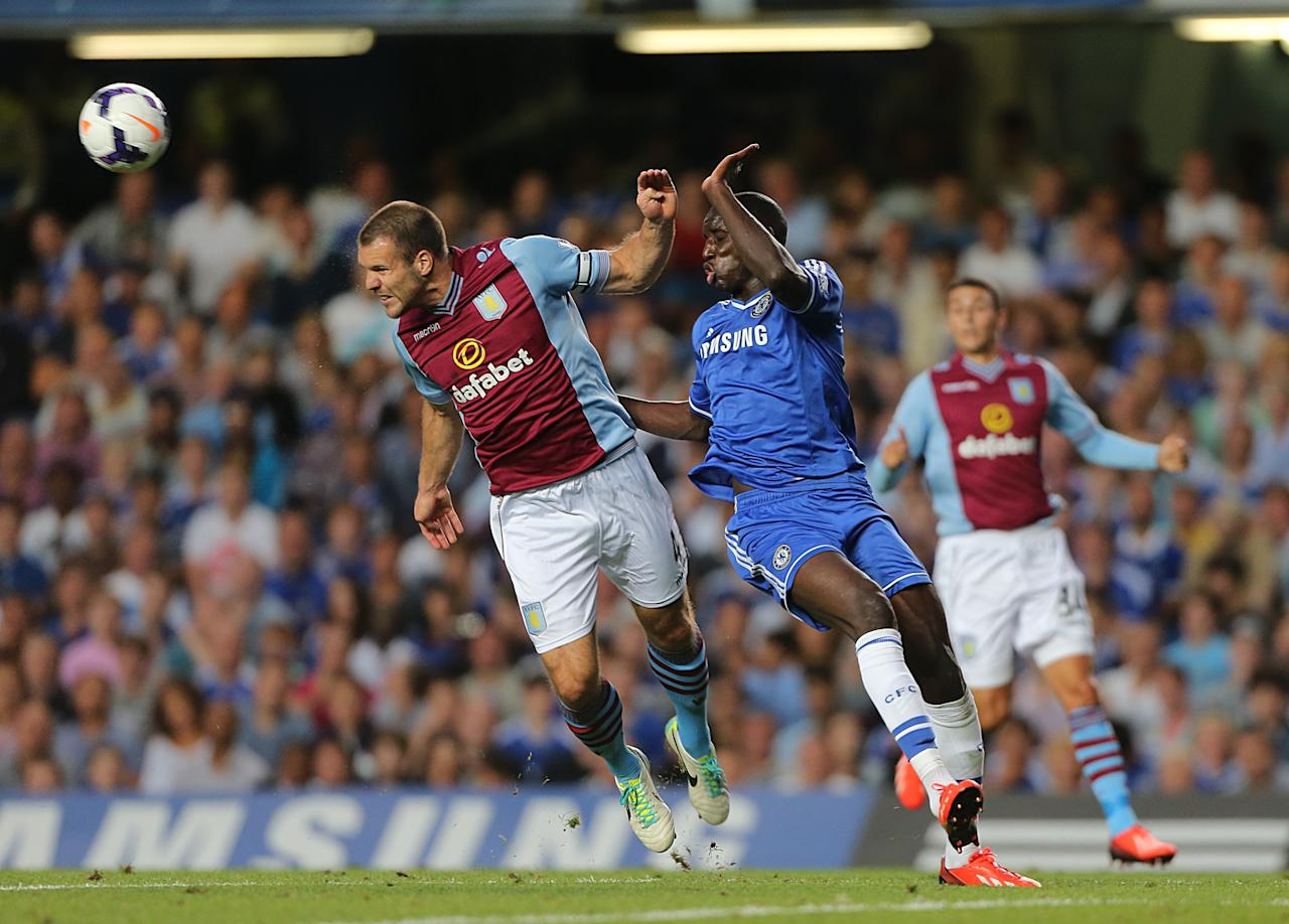 Chelsea's Demba Ba (right) and Aston Villa's Ron Vlaar (left) battle for the ball in the air