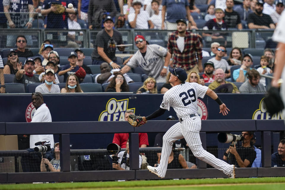 New York Yankees' Gio Urshela chases a ball hit by Tampa Bay Rays' Austin Meadows for an out during the sixth inning of a baseball game Sunday, Oct. 3, 2021, in New York. (AP Photo/Frank Franklin II)
