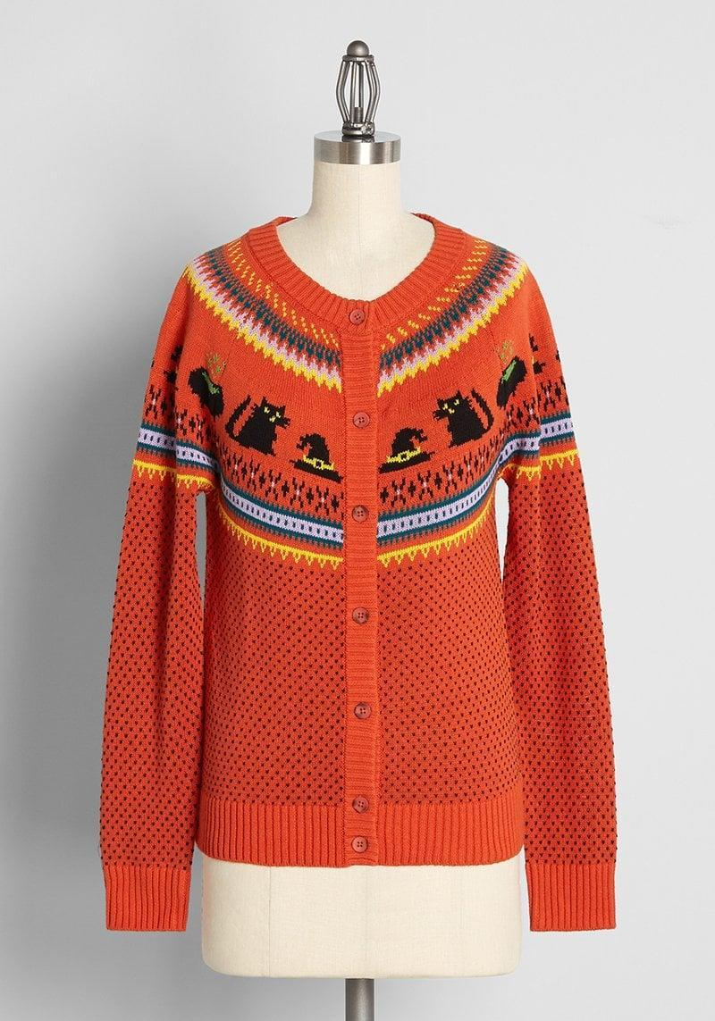 """<p>The <span>Witches Candy Fair Isle Cardigan</span> ($69) is a stunning bright-orange cardigan that will get you in the <a class=""""link rapid-noclick-resp"""" href=""""https://www.popsugar.com/Halloween"""" rel=""""nofollow noopener"""" target=""""_blank"""" data-ylk=""""slk:Halloween"""">Halloween</a> spirit. It's perfect for layering on those brisk fall evenings. </p>"""
