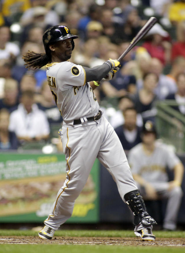 Pittsburgh Pirates' Andrew McCutchen hits a home run against the Milwaukee Brewers during the fifth inning of a baseball game Friday, Aug. 22, 2014, in Milwaukee. (AP Photo/Darren Hauck)
