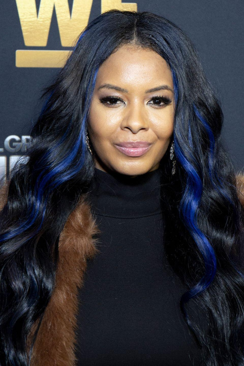 "<p>It's never a dull hair day with royal blue <a href=""https://www.goodhousekeeping.com/beauty/hair/g5063/hair-color-highlights/"" rel=""nofollow noopener"" target=""_blank"" data-ylk=""slk:highlights"" class=""link rapid-noclick-resp"">highlights</a> woven through your long curly hair.</p>"