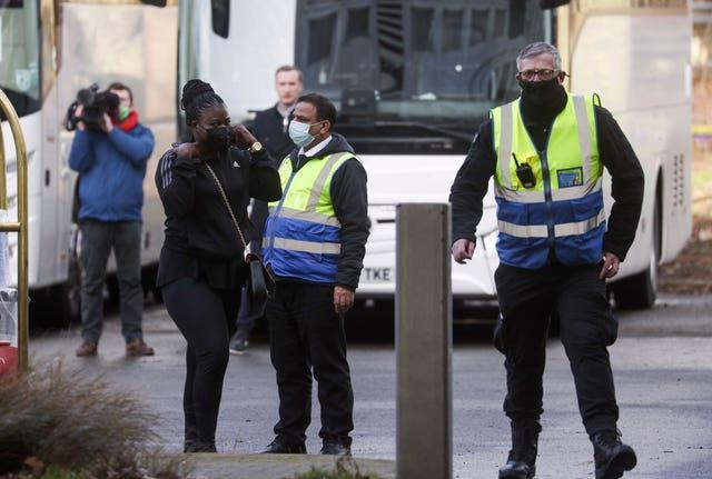 """Passengers arrive at a Holiday Inn near Heathrow Airport, where they will remain during a 10 day quarantine period after returning to England from one of 33 """"red list"""" countries"""