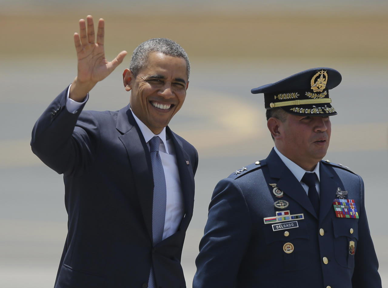 "U.S. President Barack Obama, left, waves beside Philippines Air Force chief Maj. Gen. Jeffrey Delgado before boarding Air Force One as he leaves the Ninoy Aquino International Airport in Manila, Philippines Tuesday, April 29, 2014. Obama vigorously defended his foreign policy record Monday, arguing that his cautious approach to global problems has avoided the type of missteps that contributed to a ""disastrous"" decade of war for the United States. The Philippines is the last leg of Obama's four-nation Asia tour. (AP Photo/Aaron Favila)"