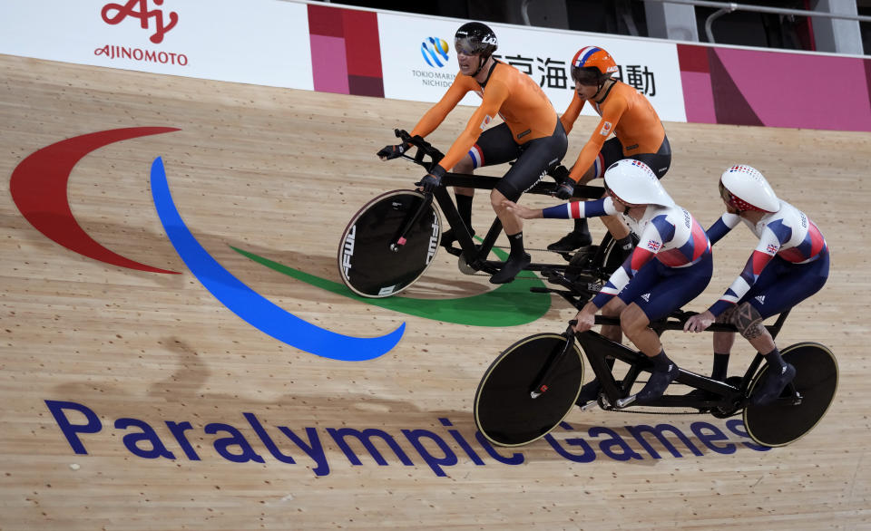 FILE - In this Aug. 25, 2021, file photo, Tristan Bangma, top right, and his pilot Patrick Bos, top left, of the Netherlands compete with Britain's Adam Duggleby, right, and his pilot Stephen Bate in the Cycling Track men's B 4000m Individual Pursuit final at the Tokyo 2020 Paralympic Games in Izu, Shizuoka prefecture, Japan. There are 4,403 Paralympic athletes competing in Tokyo, each with unique differences that have to be classified. Lines have to be draw, in the quest for fairness, to group similar impairments, or impairments that yield similar results. (AP Photo/Shuji Kajiyama)