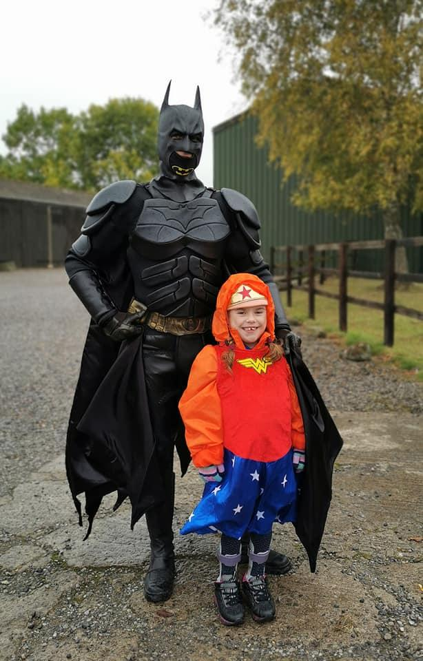Carmela was greeted on the finishing line by Batman (Muscular Dystrophy UK/PA).