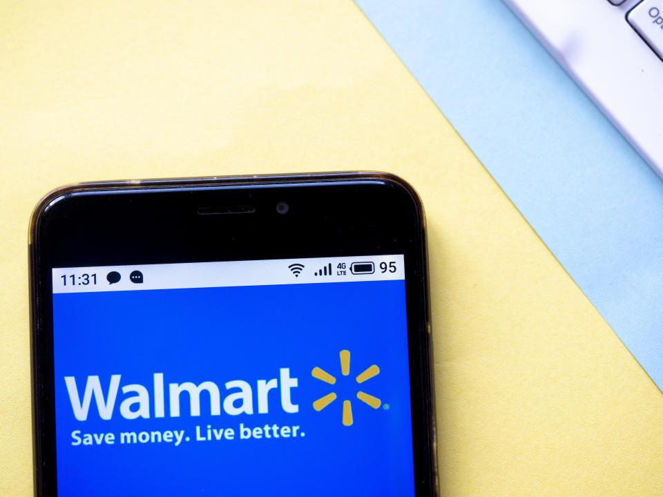 UKRAINE - 2020/03/15: In this photo illustration a Walmart logo seen displayed on a smartphone. (Photo Illustration by Igor Golovniov/SOPA Images/LightRocket via Getty Images)