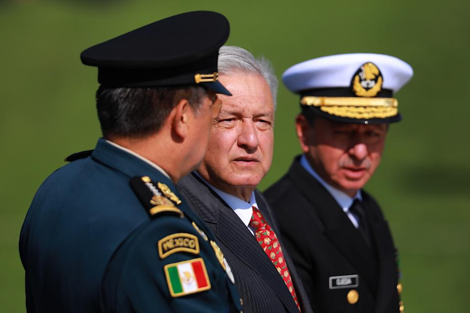 MEXICO CITY, MEXICO - JUNE 30: President of Mexico Andres Manuel Lopez Obrador (C) looks on during the ceremony of deployment of the new Mexican security force 'National Guard' at Campo Marte on June 30, 2019 in Mexico City, Mexico. The new force will be constitute by federal and military police as well as members of the Mexican Army. (Photo by Manuel Velasquez/Getty Images)