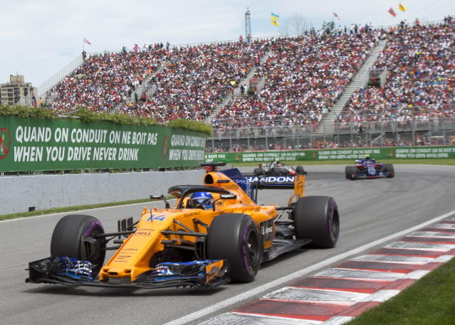 McLaren driver Fernando Alonso, of Spain, drives through the Senna corner as he starts his 300th F1 race during the Formula One Canadian Grand Prix auto race in Montreal, Sunday, June 10, 2018, in Montreal. (Ryan Remiorz/The Canadian Press via AP)