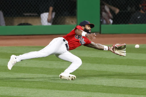 Cleveland Indians' Delino DeShields makes a diving attempt on a double by Pittsburgh Pirates' Ke'Bryan Hayes during the third inning of a baseball game, Saturday, Sept. 26, 2020, in Cleveland. (AP Photo/Ron Schwane)