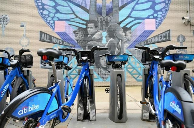Residents are making use of Citi Bikes, pictured, New York's popular bicycle share scheme which the government has temporarily made free to overwhelmed health care staff (AFP Photo/Angela Weiss)