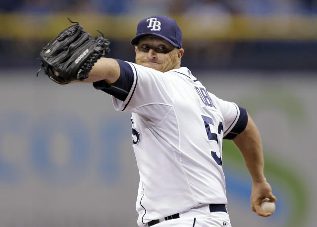 Tampa Bay Rays starting pitcher Alex Cobb goes into his windup against the Milwaukee Brewers during the first inning of a baseball game Tuesday, July 29, 2014, in St. Petersburg, Fla. (AP Photo/Chris O'Meara)