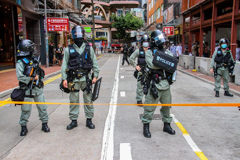 Police stand behind the cordon line during street rallies in Causeway Bay, Hong Kong, China on July 1, 2020. (Photo by Tommy Walker/NurPhoto via Getty Images) (Photo: NurPhoto via Getty Images)