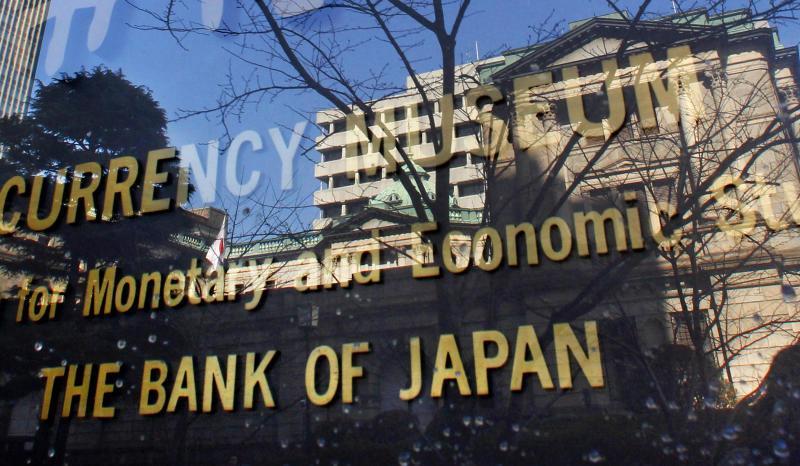 FILE - In this Feb. 15, 2011 photo, the Bank of Japan building is reflected on the glass covering the plate of its adjunct museum in Tokyo.  Japan's central bank expanded its monetary easing by 10 trillion yen ($126 billion) Wednesday, Sept. 19, 2012, moving to nurture the country's feeble economic recovery and cushion its exporters from the yen's rise against other currencies. (AP Photo/Shizuo Kambayashi, File)
