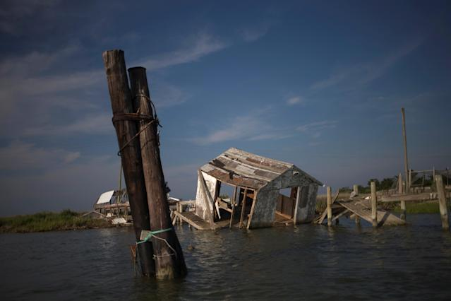 <p>A shanty, once used to sort through crabs, lies destroyed on Tangier Island, Virginia, Aug. 2, 2017. (Photo: Adrees Latif/Reuters) </p>