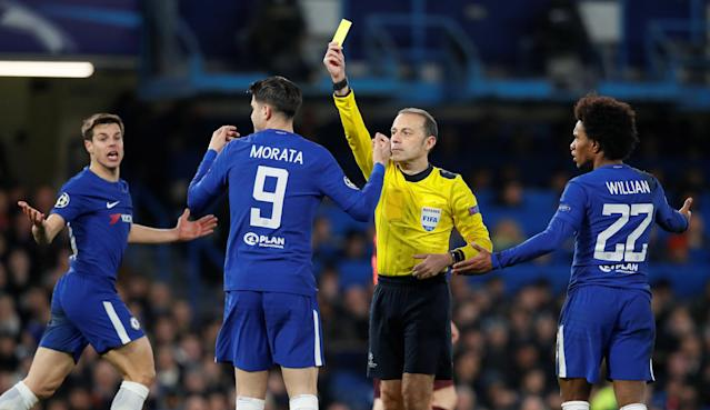 Soccer Football - Champions League Round of 16 First Leg - Chelsea vs FC Barcelona - Stamford Bridge, London, Britain - February 20, 2018 Chelsea's Alvaro Morata is shown a yellow card by referee Cuneyt Cakir REUTERS/David Klein