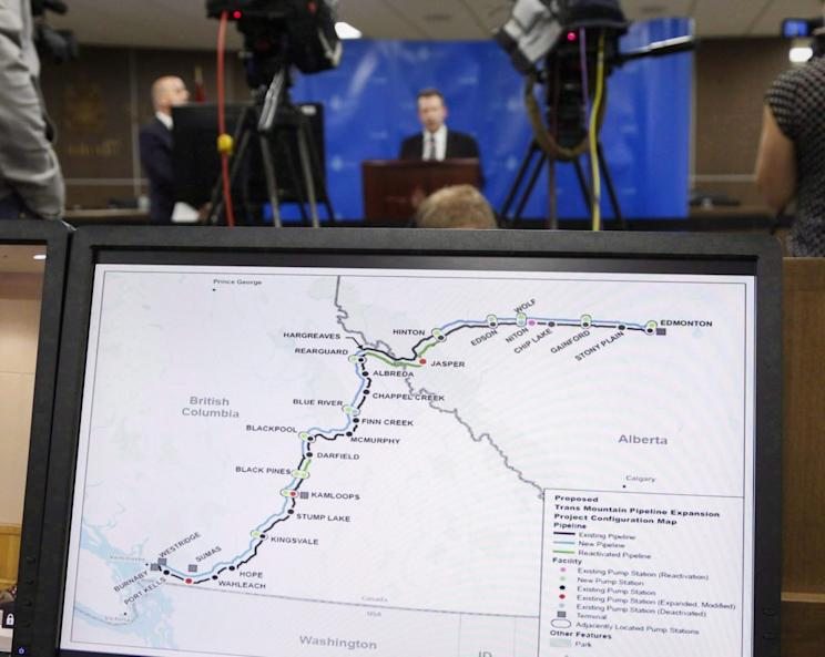 A map of the proposed Trans Mountain project seen as Dr. Robert Steedman, Chief Environment Officer of the National Energy Board releases their report on the expansion project, in Calgary in May. The Canadian Press/Jeff McIntosh