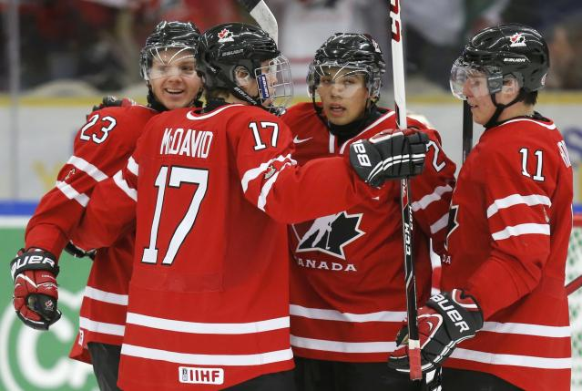 Canada's Sam Reinhart (L) celebrates his goal against the Czech Republic with teammates Connor McDavid (17), Bo Horvat (R) and Matt Dumba during the first period of their IIHF World Junior Championship ice hockey game in Malmo, Sweden, December 28, 2013. REUTERS/Alexander Demianchuk (SWEDEN - Tags: SPORT ICE HOCKEY)