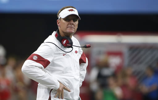Arkansas head coach Chad Morris looks on as his team plays Texas A&M during the first half of an NCAA college football game Saturday, Sept. 28, 2019, in Arlington, Texas. Texas A&M won 31-27. (AP Photo/Ron Jenkins)