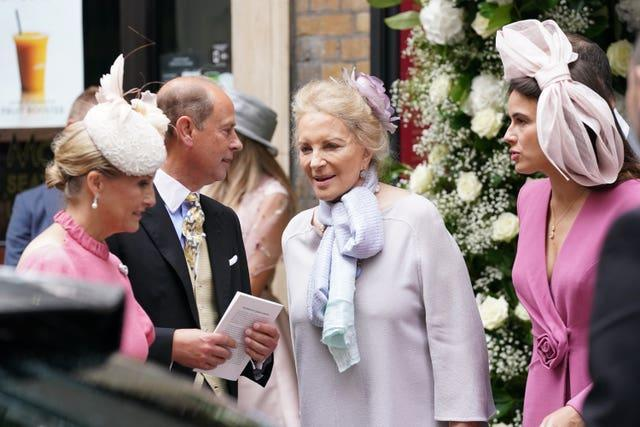 The Earl and Countess of Wessex talk to Princess Michael of Kent, centre, following the wedding of Flora Ogilvy