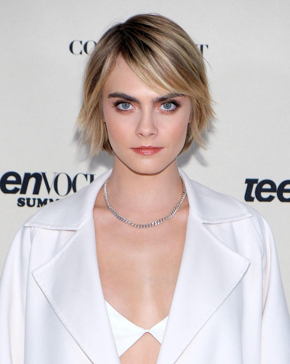 <p>Here, Delevingne's gorgeous golden highlights and lowlights are what not only give her hair dimension, but also what soften the piecey ends, which are leftover from her shorter, shaggy pixie cut.</p>