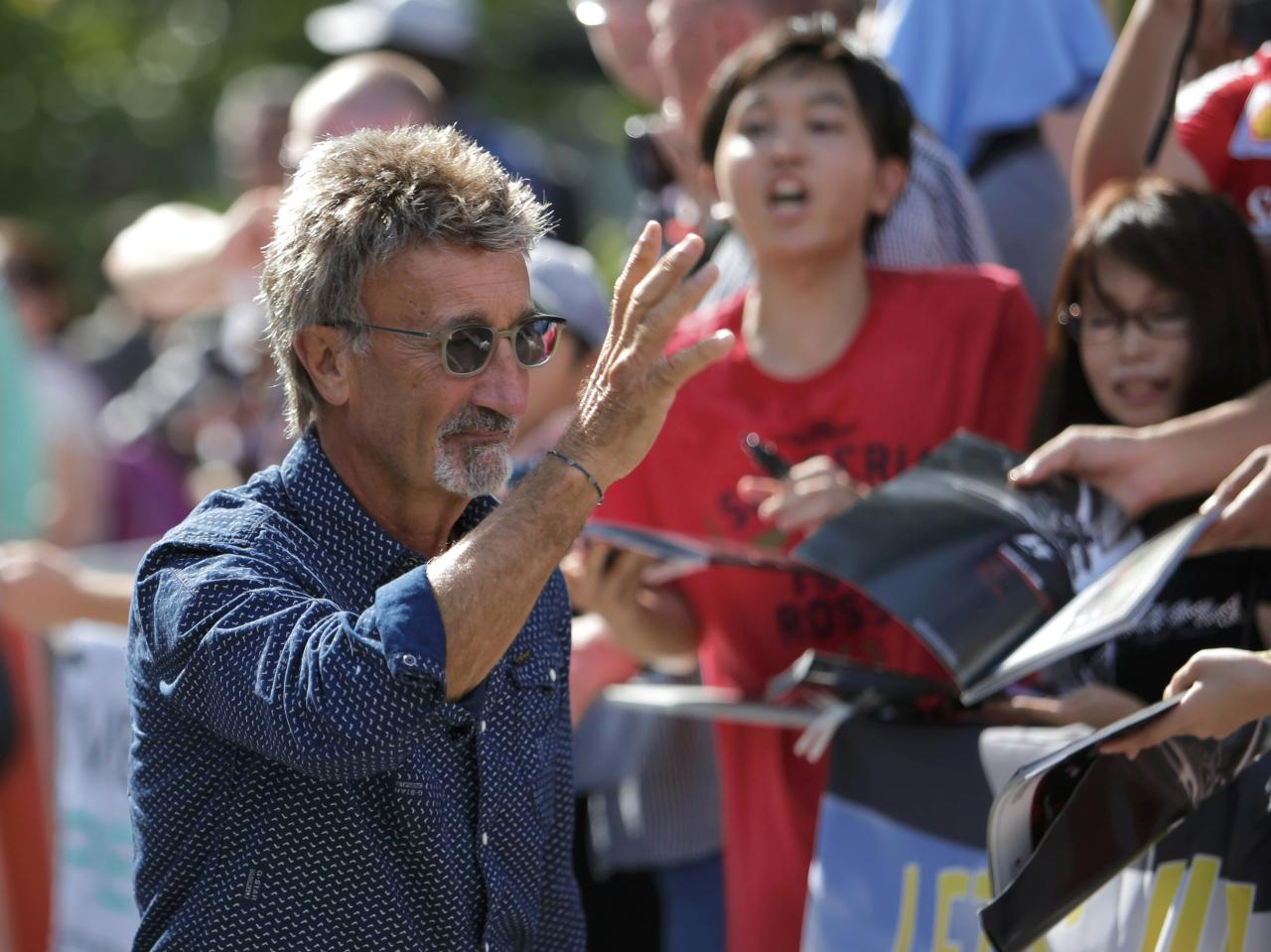 Former race driver Eddie Jordan of Ireland arrives at the track ahead of the third practice session of the Singapore F1 Grand Prix at the Marina Bay street circuit in Singapore September 21, 2013. REUTERS/Tim Chong (SINGAPORE - Tags: SPORT MOTORSPORT F1)