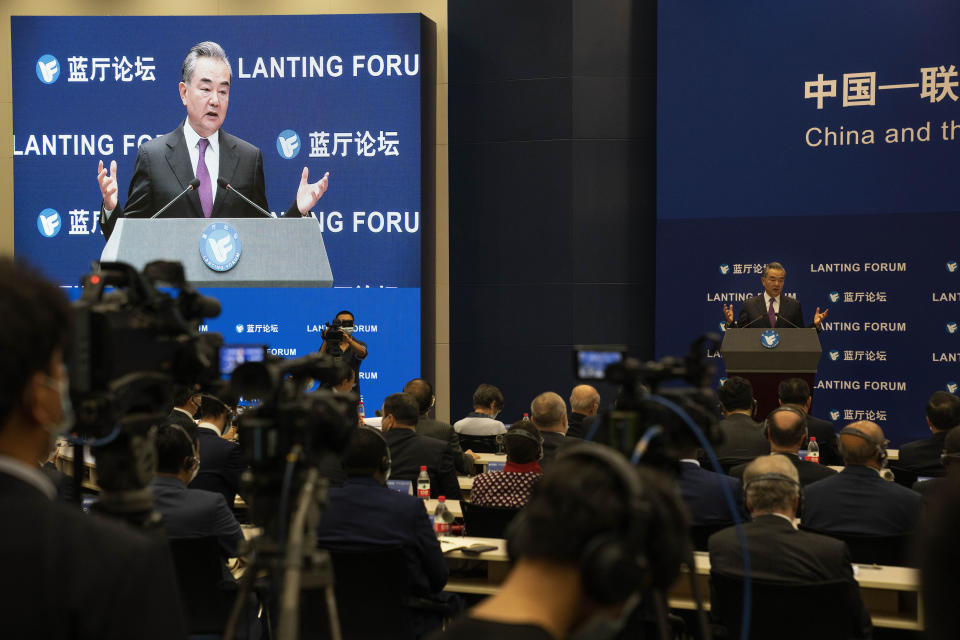 Chinese Foreign Minister Wang Yi speaks during a symposium to mark the 50th anniversary of the People's Republic of China's entry into the U.N. at the Foreign Ministry in Beijing on Friday, June 25, 2021. Foreign Minister Wang Yi said China remains deeply committed to United Nations peacekeeping efforts, where more than 2,400 Chinese troops and police are serving, a contribution that underscores China's increasing prominence in the world body. (AP Photo/Ng Han Guan)