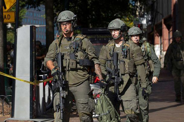 PHOTO: Montgomery police officers in tactical gear exit a parking garage where a police officer was shot, in Silver Spring, Md., Oct. 14, 2019. (Jose Luis Magana/AP)