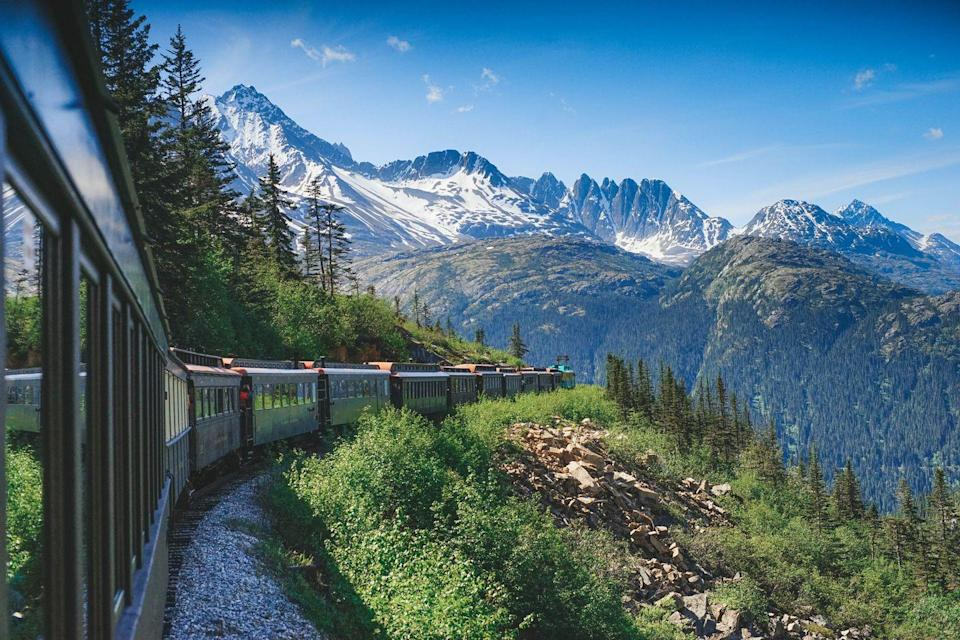 """<p>If your budget and schedule permits, let yourself be enchanted by the <a href=""""https://www.oprahmag.com/life/g25736964/scenic-train-rides-routes/"""" rel=""""nofollow noopener"""" target=""""_blank"""" data-ylk=""""slk:old-fashioned charm of railway travel—"""" class=""""link rapid-noclick-resp"""">old-fashioned charm of railway travel—</a>through a winding countryside, soaking up a coastal view, or across mountainous terrain.</p>"""