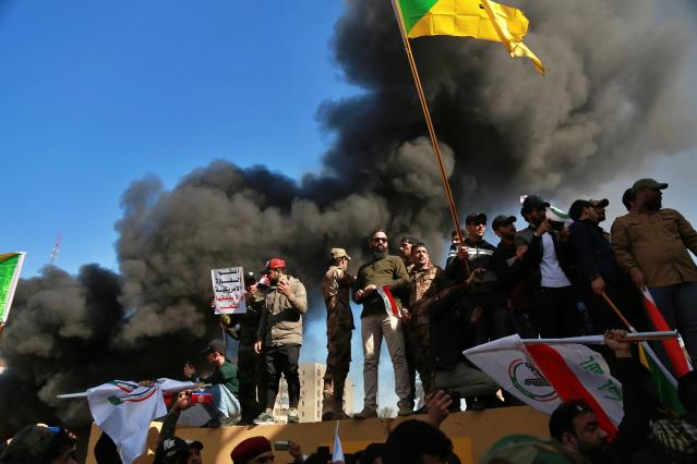Protesters gather in front of the U.S. Embassy in Baghdad on Dec. 31 following deadly U.S. airstrikes on Dec. 29 that killed 25 fighters of the Iran-backed militia in Iraq. (Photo: Khalid Mohammed/AP)