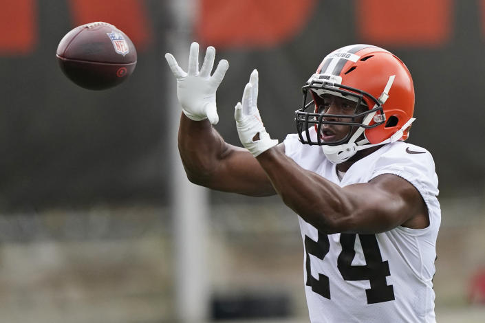 Cleveland Browns running back Nick Chubb catches a pass during an NFL football practice, Thursday, July 29, 2021, in Berea, Ohio. (AP Photo/Tony Dejak)
