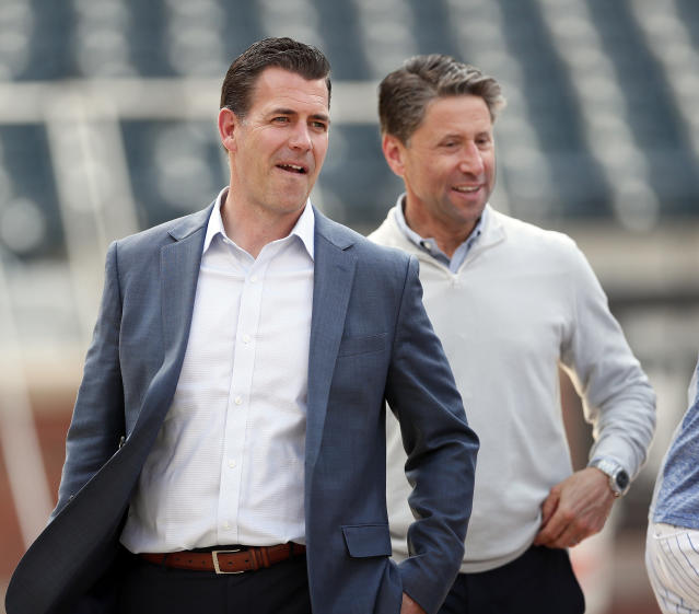 "NEW YORK, NY - MAY 20: General Manager Brodie Van Wagenen and Chief Operating Officer Jeff Wilpon of the <a class=""link rapid-noclick-resp"" href=""/mlb/teams/ny-mets/"" data-ylk=""slk:New York Mets"">New York Mets</a>, talk on the field during batting practice moments after Van Wagenen held a press conference before an MLB baseball game against the <a class=""link rapid-noclick-resp"" href=""/mlb/teams/washington/"" data-ylk=""slk:Washington Nationals"">Washington Nationals</a> on May 20, 2019 at Citi Field in the Queens borough of New York City. Mets won 5-3. (Photo by Paul Bereswill/Getty Images)"