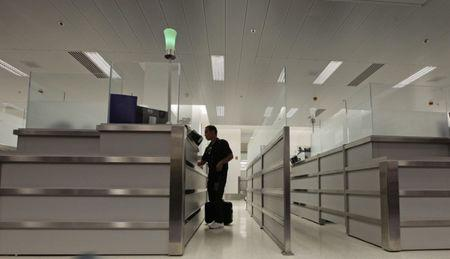 Luis Salgado stands at the counter of U.S. Immigration upon arriving at Miami airport on a direct flight from Havana