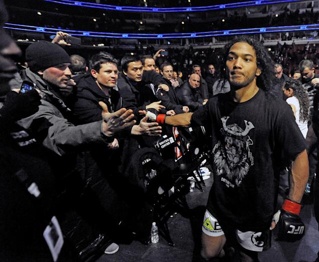 Benson Henderson celebrates with fans after defeating Josh Thomson during the main event of the UFC mixed martial arts match in Chicago, Saturday, Jan., 25, 2014. (AP Photo/Paul Beaty)